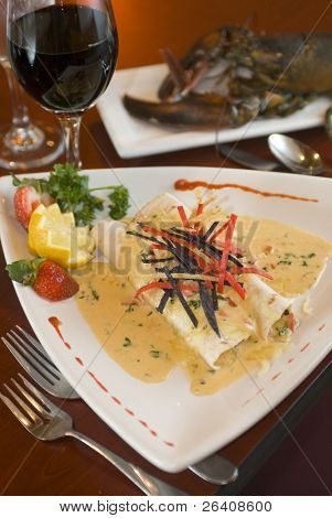 Gourmet fresh lobster rolls with cream sauce and red wine