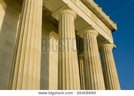 Beautiful sun lit building columns background texture with blue sky 03