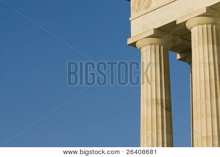 Beautiful sun lit building columns background texture with blue sky 05
