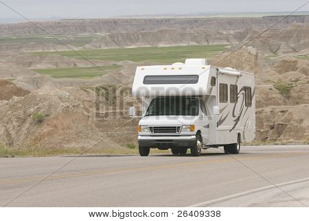 RV class C climbing scenic mountain road in the Badlands