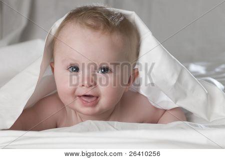 Happy healthy baby boy portrait on white background