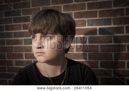 Young frustrated angry adolescent boy