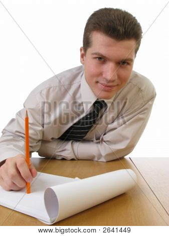 Young Businessman Holding Red Pencil And Smiling, Isolated