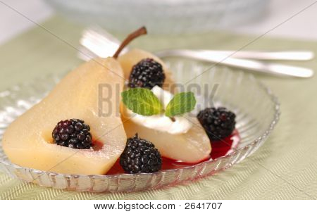 Pear Poached In White Wine With Blackberry Sauce