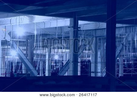 A construction site at night with hanging metal tape