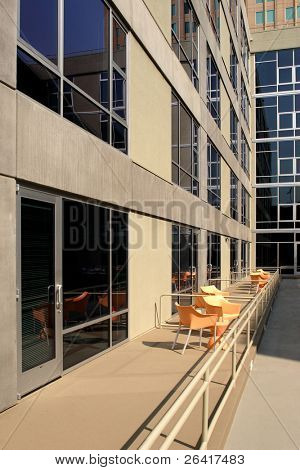 A modern loft courtyard with tables and chairs