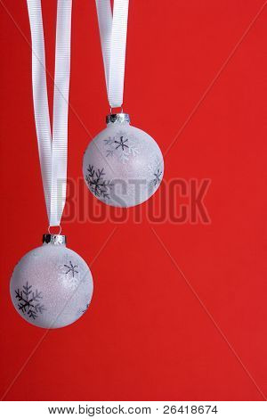 White christmas orniments isolated on red in the studio