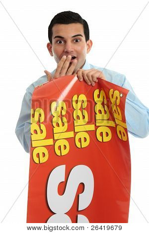 Retail Shopkeeper With Sale Sign,