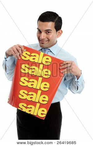 Retail Salesman Holding A Sale Sign Banner