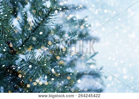 poster of Closeup Of Christmas Tree With Light, Snow Flake. Christmas And New Year Holiday Background. Vintage