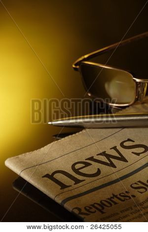 newspaper and eyeglasses