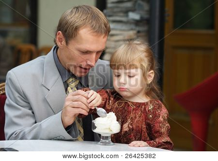 father and daughter in cafe