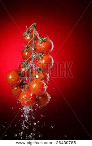 cherry tomato in water splash