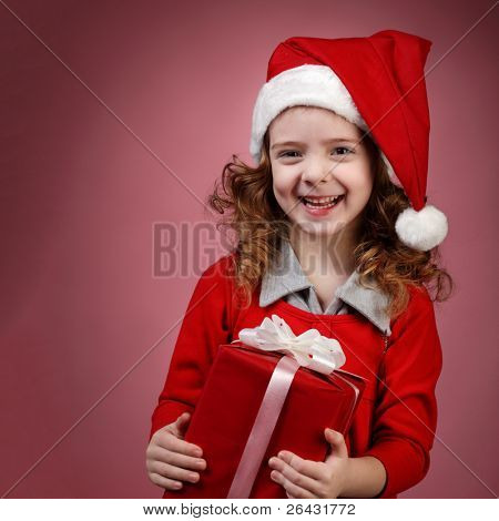 Happy little girl open red gift box
