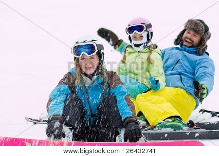 Winter, ski sun and fun - happy skiers playing in snow