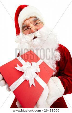 Photo of happy Santa Claus with red giftbox looking at camera