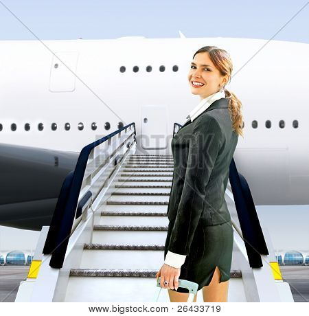 beautiful flight attendant near moving ramp in airport