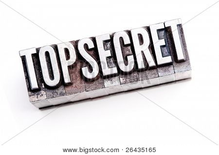 "The phrase ""Top Secret"" in letterpress type. Cross processed & narrow focus."