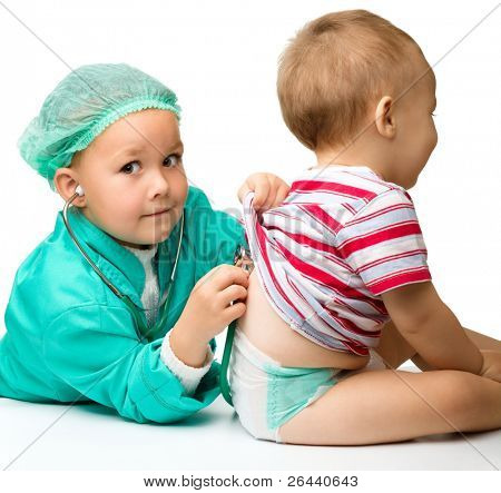 Cute children are playing doctor with stethoscope, isolated over white