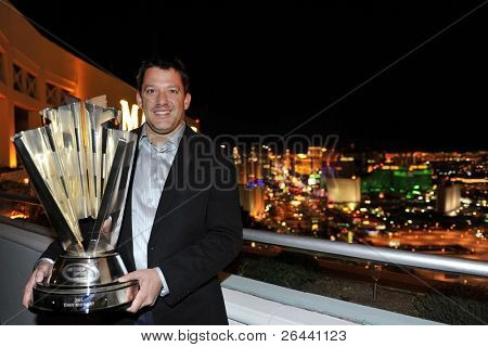 LAS VEGAS, NV - NOV 30: Tony Stewart displays the Nascar Sprint Cup Champion trophy at the Mandalay Bay for the Nascar Sprint Cup Series Champion's Week in Las Vegas, NV on Nov 30, 2011