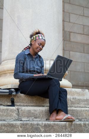 African American College Student With Laptop