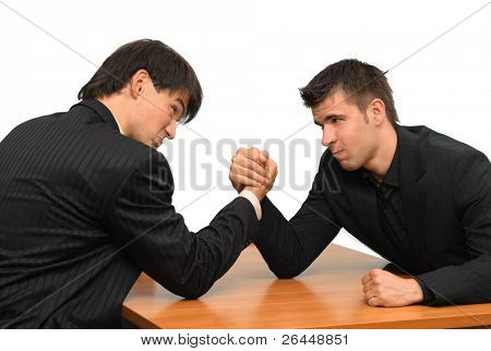 Two businessmen competing in arm wrestling
