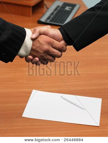 Successful deal concept - handshake closeup photo.