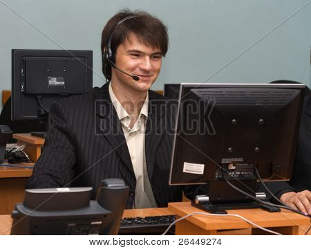 Young businessman in his office, working with the computer