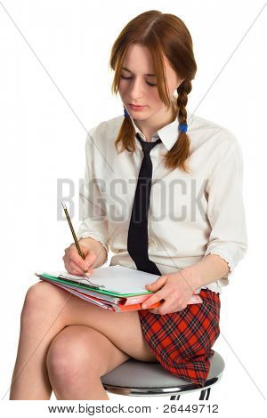 Beautiful lady writing on a worksheet, white background