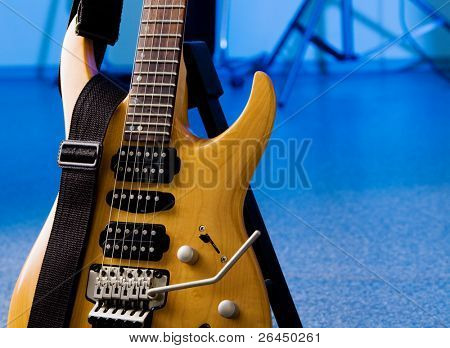 Electric 24-fret guitar closeup isolated on white background