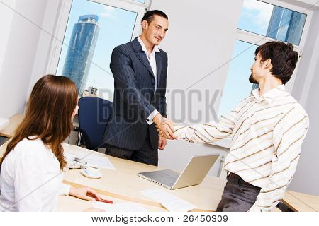 Handshake illustrating successful cooperation with a partner or customer