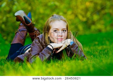 Beautiful Young Woman Lies On Grass