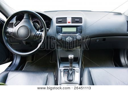 Modern car dashboard and front seats view