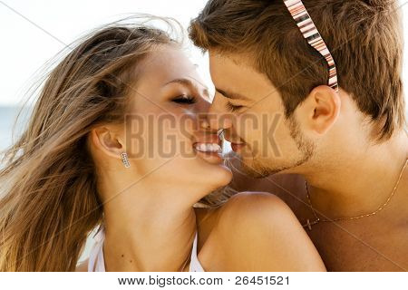 Romantic couple kissing on the seaside
