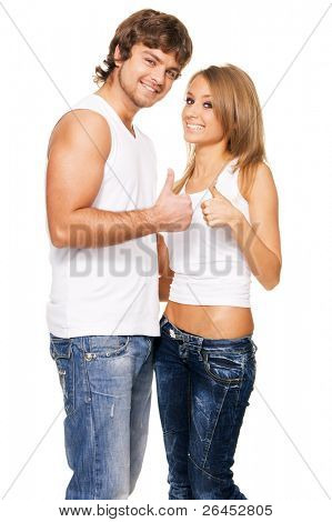 Beautiful young couple in casual clothing showing thumbs up sign