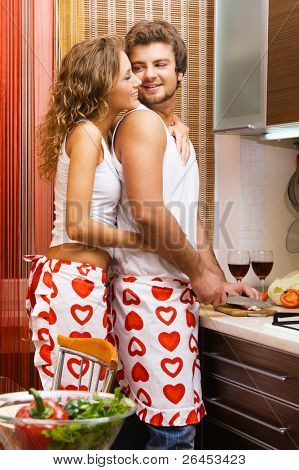 Young beautiful couple in their kitchen