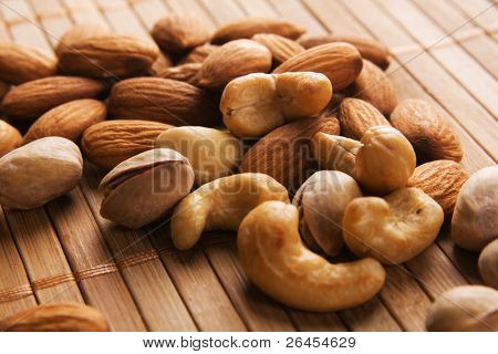 Cashew, almond and pistachios macro photo