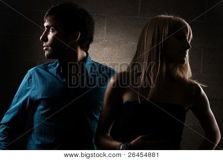 Dramatic portrait of a young elegant couple