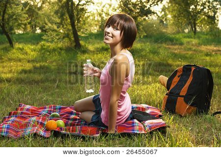 Lovely girl having a rest on picnic in the park