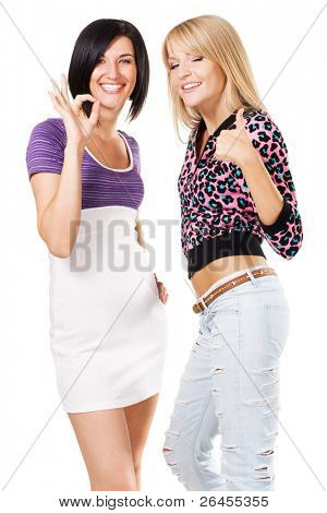 "Two young beautiful woman showing ""Thumbs up"" and ''Ok'' signs. Isolated on white background"