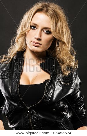 Portrait of a beautiful sexy woman in black leather jacket