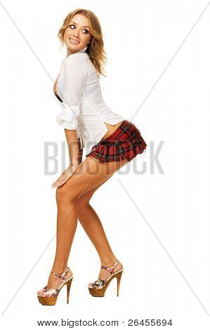 Lovely sexy girl in checkered short skirt on white background