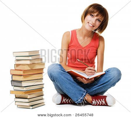 Lovely student girl writing at note pad, white background