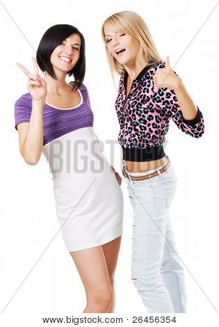 "Two young beautiful women showing ""Thumbs up"" and ''Peace'' signs, white background"
