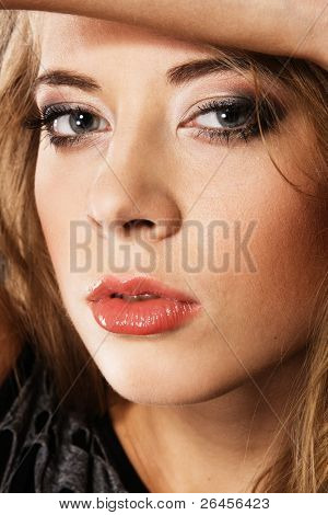 Young beautiful woman face portrait with all skin details preserved