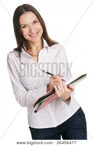 Young businesswoman with a bunch of documents writing at note pad, white background