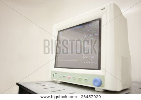Medical monitor at the surgery room controlling vital signs