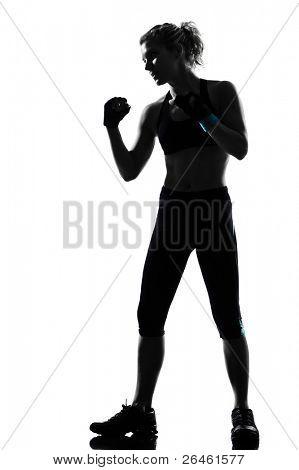 una mujer ejerciendo postura de ejercicio aeróbico de fitness entrenamiento sobre fondo blanco de estudio aislado