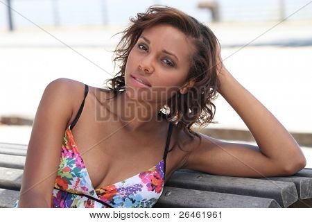 Summery woman sitting on a bench