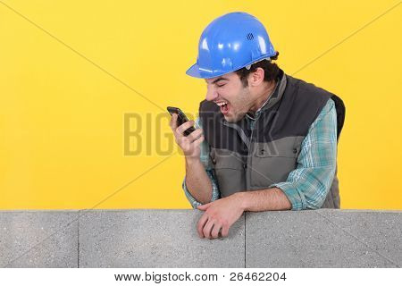 Builder shouting down his cellphone